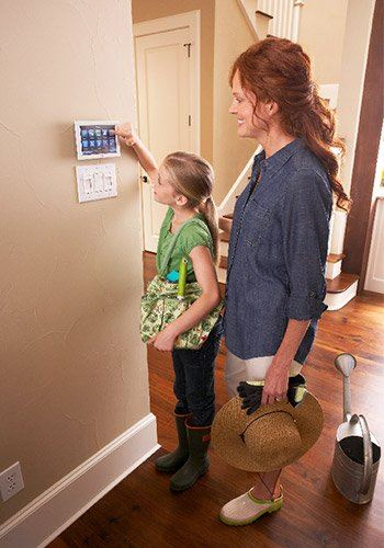 Mother and daughter using the Trane Nexia thermostat
